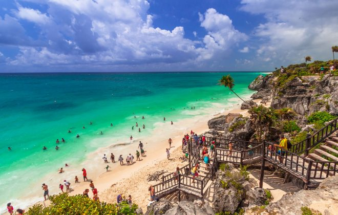 Riviera Maya, Cliff with stairs leading to white sand beach at Tulum overlooking the Gulf of Mexico